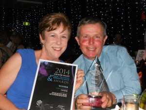 Patti and Tim at the Awards night with the trophy and certificate